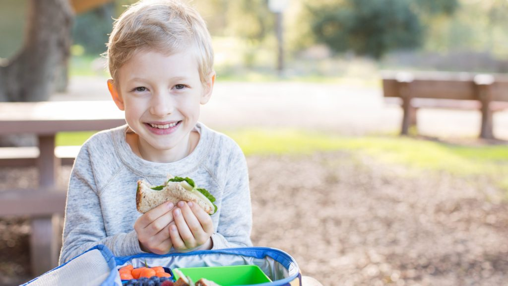 Child eating lunch outside